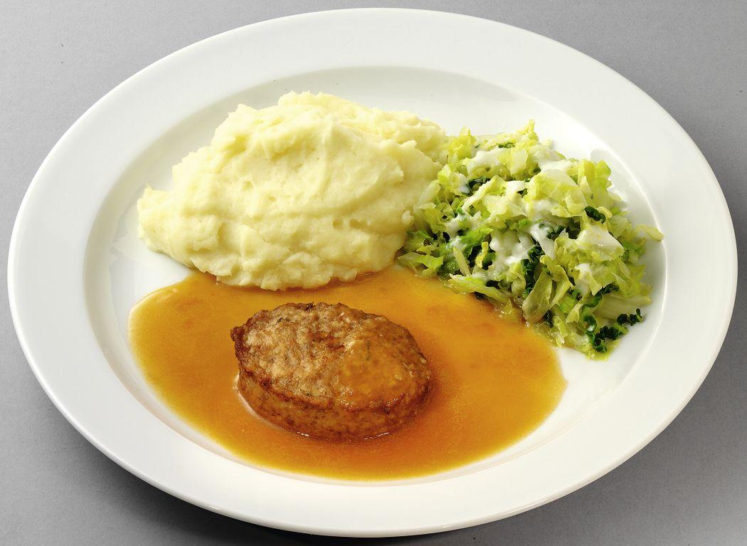 Geflügelfrikadelle in Bratensoße mit Wirsinggemüse und Kartoffelpüree